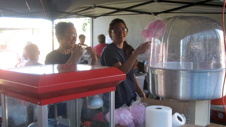 Volunteers helping at the SETFA cotton candy station.