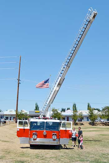 SETFA's (Yelm & Rainer Fire Dept.) Ladder truck fully extended at Family Fun Day event at Yelm City Park.