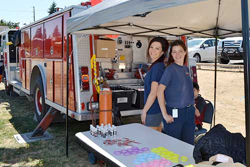 SETFA (Yelm & Rainier Fire Department) volunteers, Ksea Rogers and Erika McInnis.
