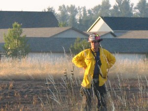 SETFA (Yelm & Rainier) Fire Captain Eric Hetland surveys the damage to a field in Yelm that burned during the 4th of July weekend.