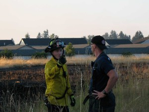 SETFA (Yelm & Rainier) Firefighter Matt Blasco (left) talks to SETFA  Firefighter Tony Brosco (right).