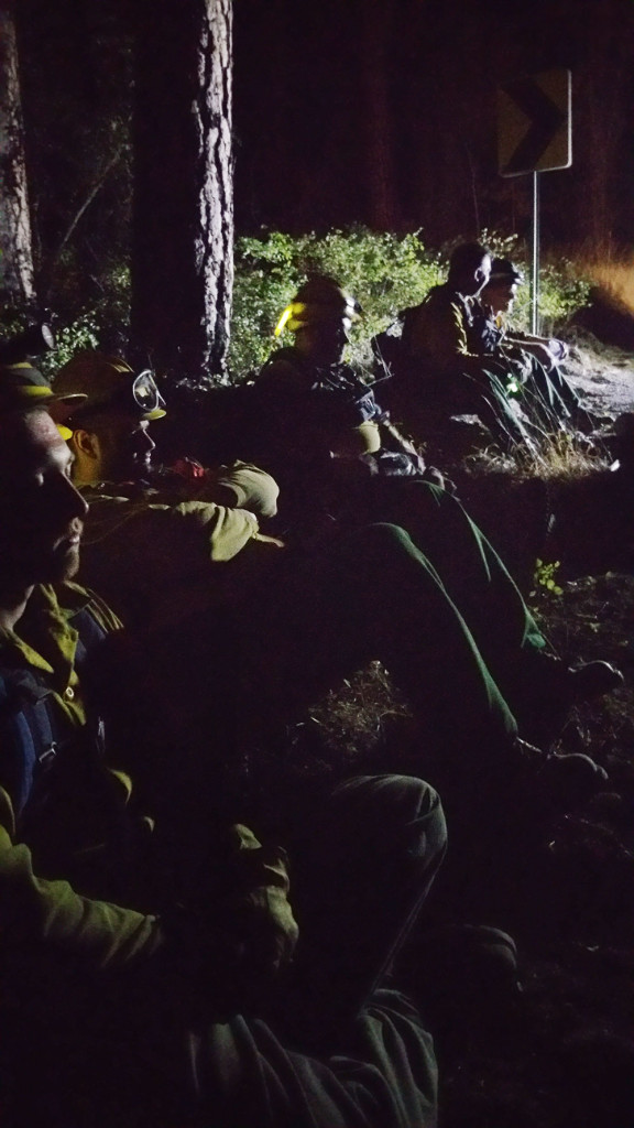 Crew catching some rest, while they can, on a fire near Colville, Washington